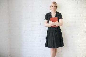 Smiling woman holding folder