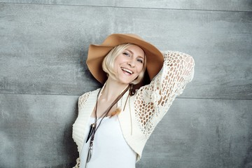 Confident woman in hat