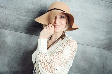 Playful woman in hat