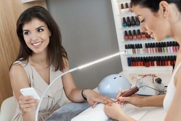 Beautiful woman at manicurist