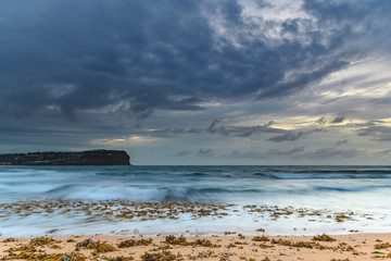 Cloudy Sunrise Seascape with Seaweed