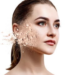 Young woman face made from crumbly powder.