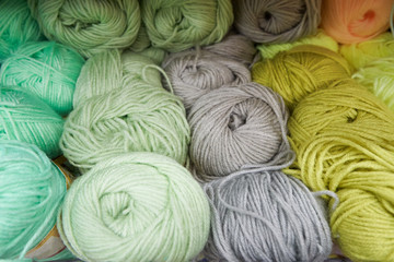 Threads for knitting different colors on the shelf in the store. Close up