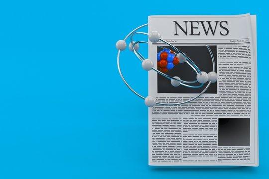 Atom model with newspaper