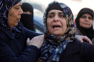 The mother of Palestinian Raed Hamdan, reacts during his funeral in Nablus, in the Israeli-occupied West Bank