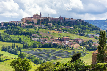 Camerino in Italy Marche over colourful fields
