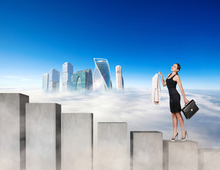 Business woman climbing the concrete stairs blocks.
