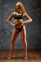 Young sporty girl with athletic body