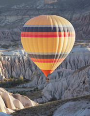 Hot air balloon flying over the canyon