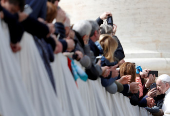 Pope Francis greets faithful during the Wednesday general audience in Saint Peter's Square, at the Vatican