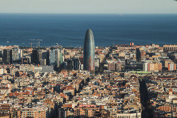 A view of Barcelona city, with the mediterranean sea at the bottom.