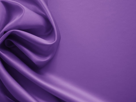 Beautiful smooth elegant wavy violet purple satin silk luxury cloth fabric texture, abstract background design. Card or banner.