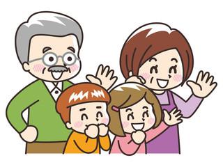 手を振る祖父母と孫