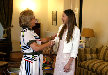 Venezuela's opposition leader Juan Guaido's wife, Fabiana Rosales shakes hands with the Chilean first lady Cecilia Morel during a visit at the government palace in Santiago