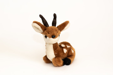 Brown plush toy smiling deer on a white background, isolated