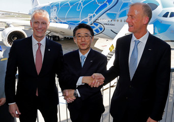 Airbus Chief Executive Tom Enders, Japan's ANA Holdings President and CEO Shinya Katanozaka and Chris Cholerton, President of Civil Aerospace at Rolls Royce pose during the delivery ceremony of the first A380 for All Nippon Airways (ANA) in Colomiers