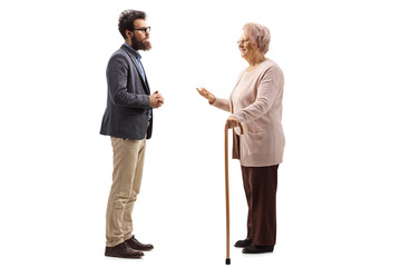 Senior woman with a cane talking to a bearded man