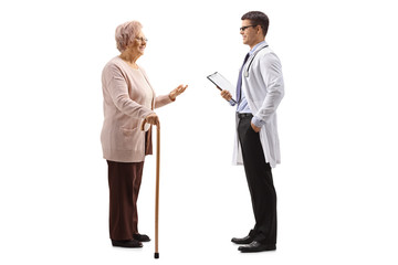 Old lady with a cane talking to a young male doctor