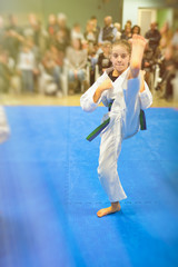 Young girl in karate attacking position