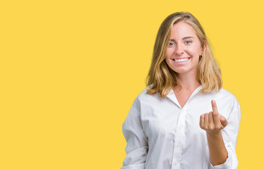 Beautiful young business woman over isolated background Beckoning come here gesture with hand inviting happy and smiling