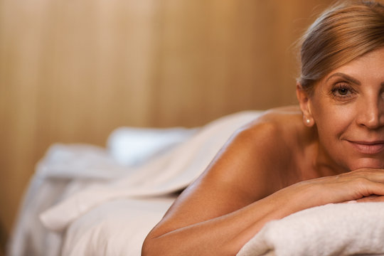 Beautiful mature woman relaxing at the spa