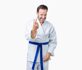 Handsome middle age senior man wearing kimono uniform over isolated background Beckoning come here gesture with hand inviting happy and smiling