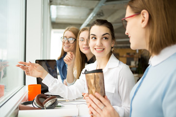 Group of young businesswomen working together