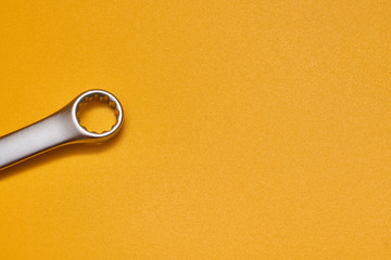 wrench isolated on yellow background