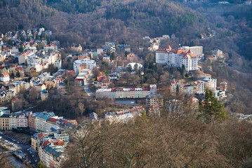Karlovy Vary, Czech Republic - March 04, 2019: Aerial view of the city and the mountains on the horizon