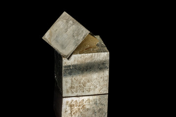 Macro mineral stone Pyrite on a black background