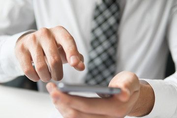 Close up telephone. Sending email, mobile phone. Businessman working with documents White background. Shopping online. Office work concept. Businessman uses a smartphone.