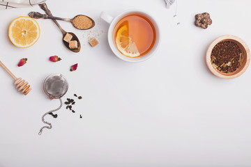 Wall Mural - Creative composition witn variety of tea, sugar, lemon and other accessories for making tea