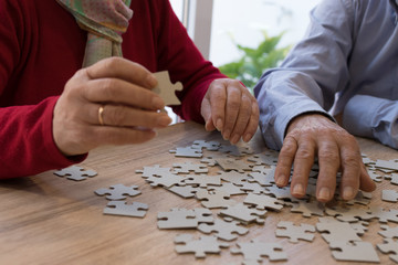 older hands making a puzzle, memory exercises Wall mural