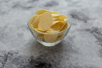 Crispy potato chips.The concept of fast food and snacks.