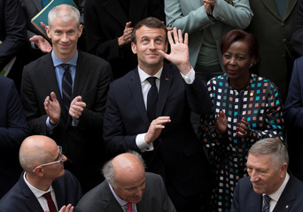 France's President Emmanuel Macron poses for a family photo at the International Organisation of La Francophonie (OIF) headquarters in Paris