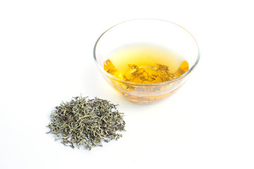 Dry grass and Herbal infusion of moss. Alternative herb medicine. Isolated white background.