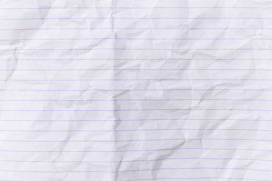 Top view empty lined paper with wrinkled background and texture.