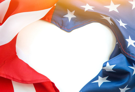 Closeup of American flag USA on white background. free heart space for text. flatlay
