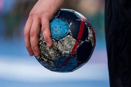Player holding the ball for handball