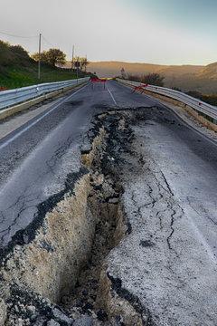 Asphalt road destroyed by the landslide
