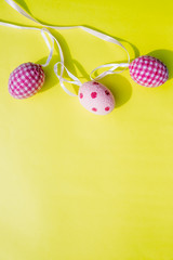 Easter card and eggs hanging on the clothesline.Easter. Easter symbol. Holidays card. Easter greetings.Copy space.Trendy flat lay easter. Minimal easter concept.Traditional Christian religious symbols