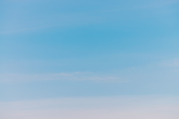 Blue day clear sky with light clouds. Smooth blue white gradient of sky. Wonderful weather. Background of morning. Heaven at morning with copy space. Slightly cloudy backdrop. Atmosphere of clear day.