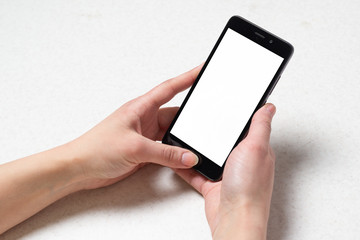 Two hands holding black smartphone on white background
