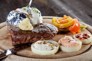 Rustic beef steak with oven potato