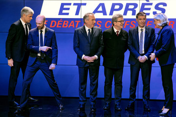 French political party chiefs take their position for a picture ahead of a debate organised by French BFM TV in Paris
