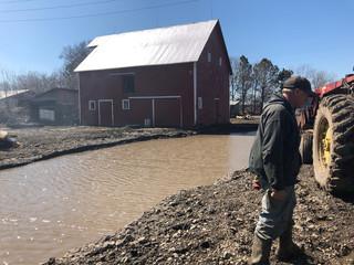 Tom Geisler surveys damaged to his farm, following flooding in Winslow, outside Omaha, Nebraska