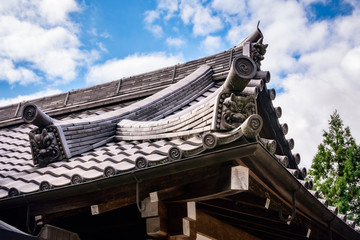 Specific carvings on a traditional Japanese roof at Kiyomizu-dera buddhist temple in Kyoto, Japan.