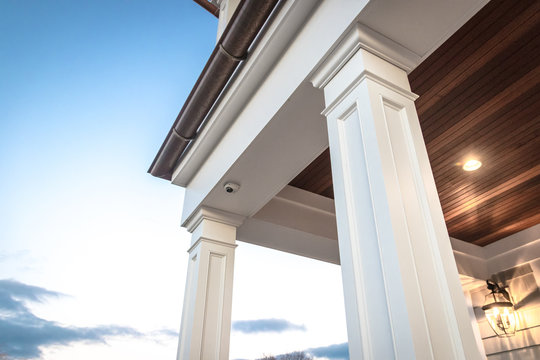 Strong columns and trim of modern home exterior.