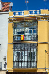 Yellow Building and Spanish Flag