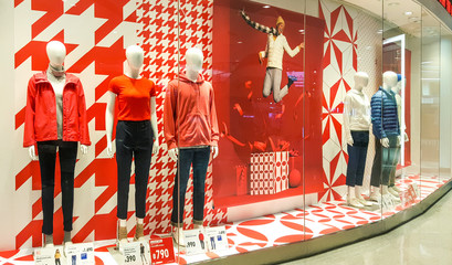 Front of Uniqlo store. Luxury and fashionable brand window display. Winter collection Welcoming the Christmas Festival.